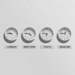 4 clocks depicting time around the world